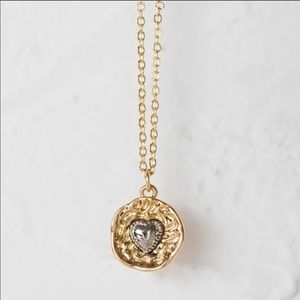 Silver heart medallion necklace. NIB.